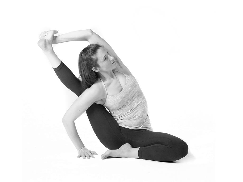 Student practicing Yoga compass pose