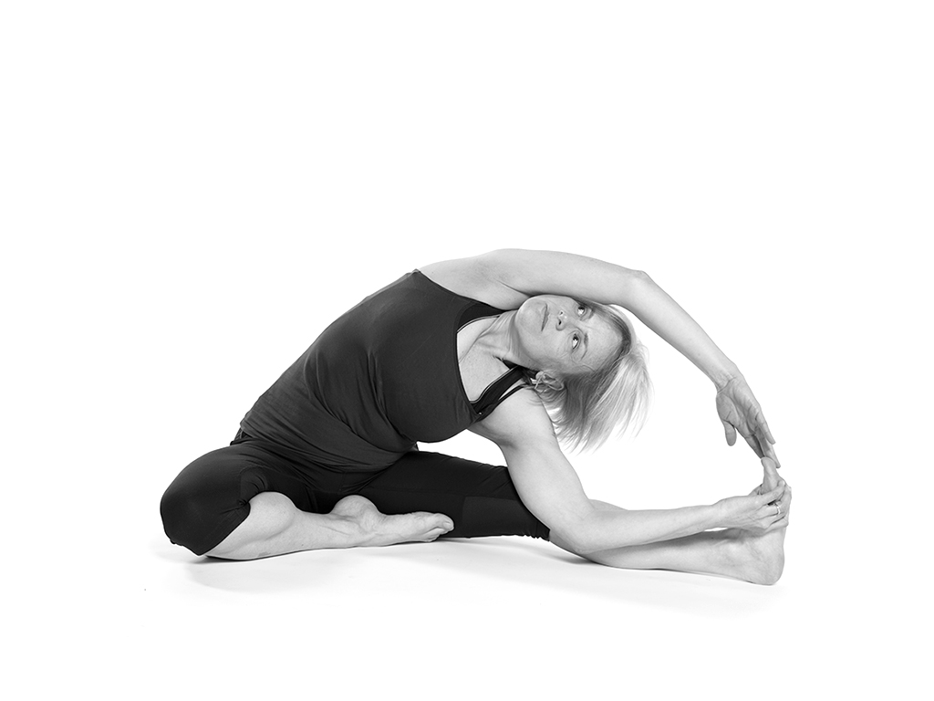 Student practicing Yoga Boat pose