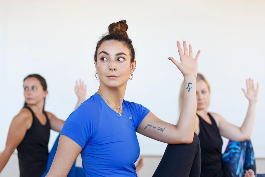 Yoga students practicing revolved Marychyasana (C)