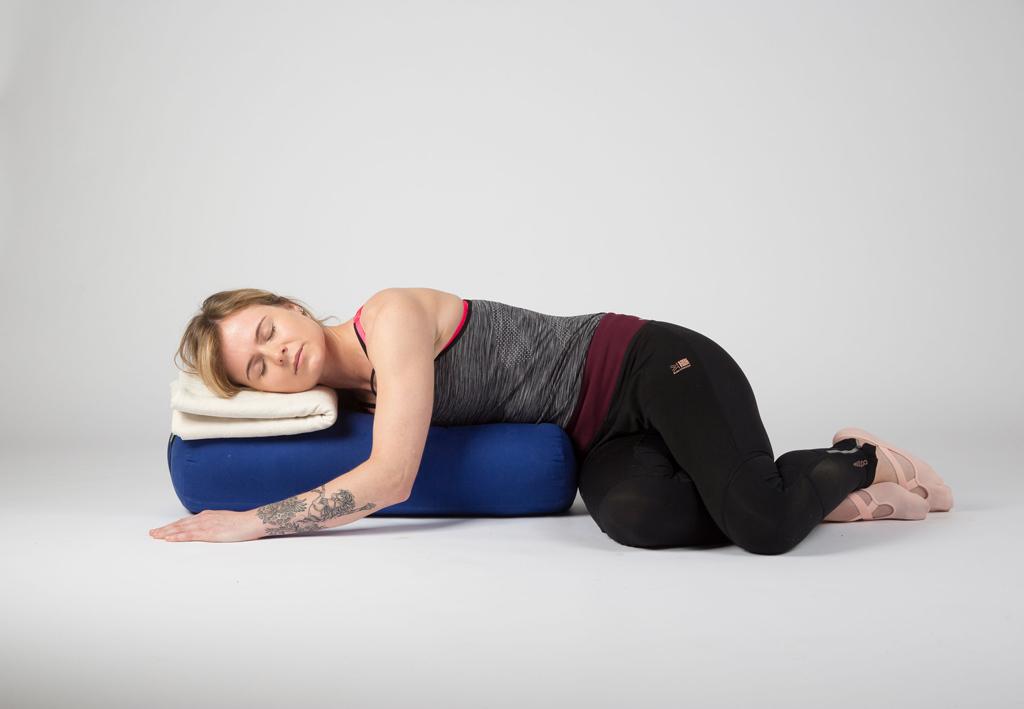 yoga student in restorative twist