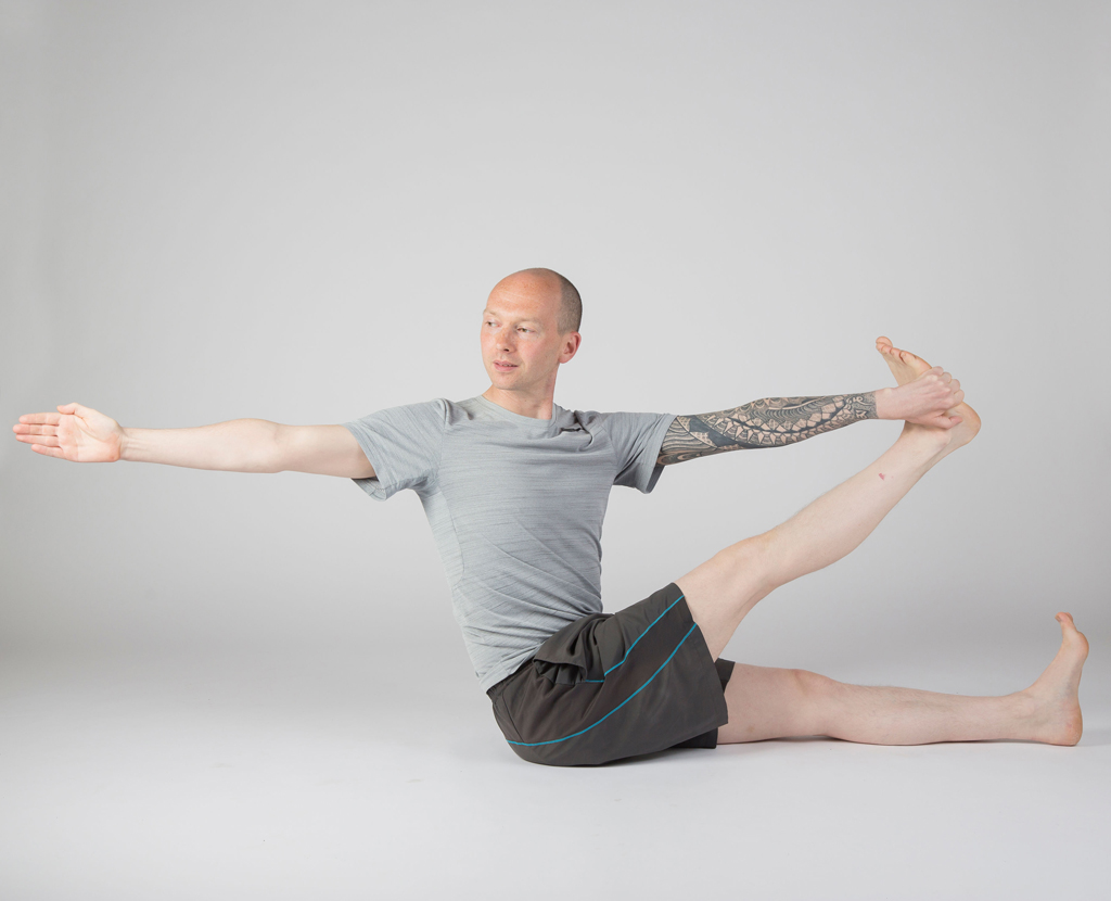 Yoga student practicing archer pose