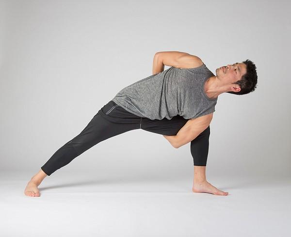 Yoga students practice side bind