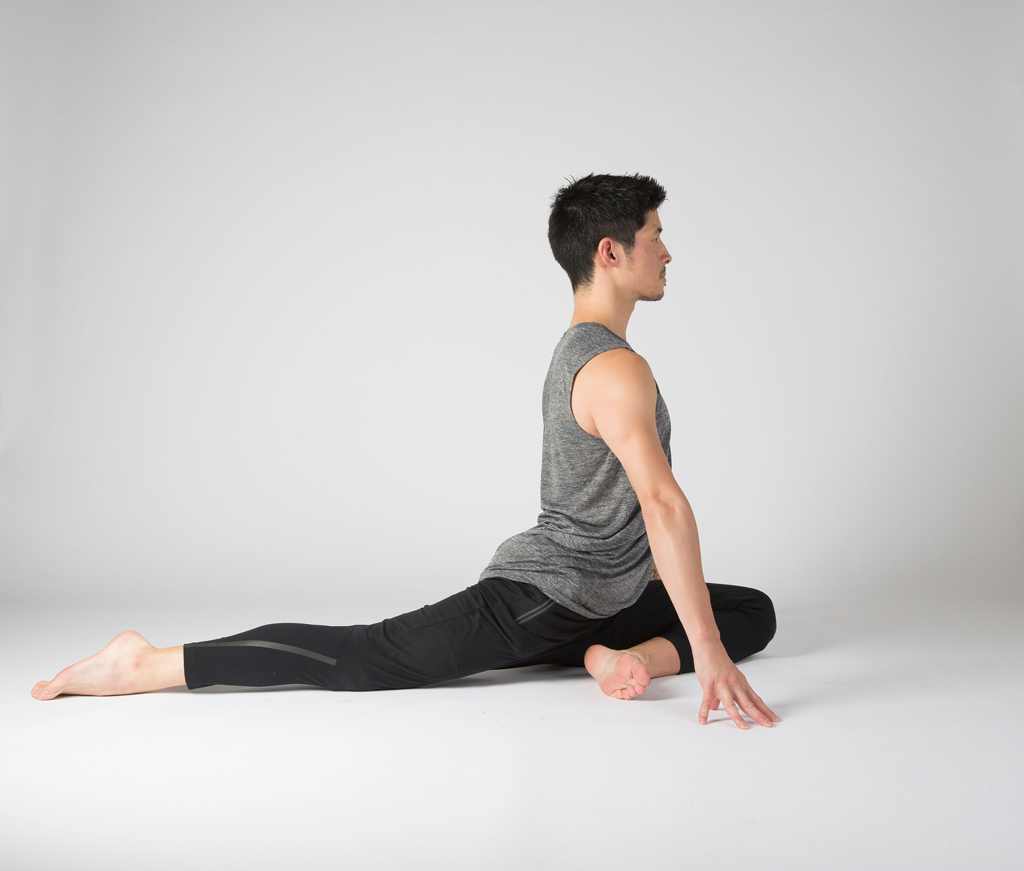Yoga students are practicing skandasana