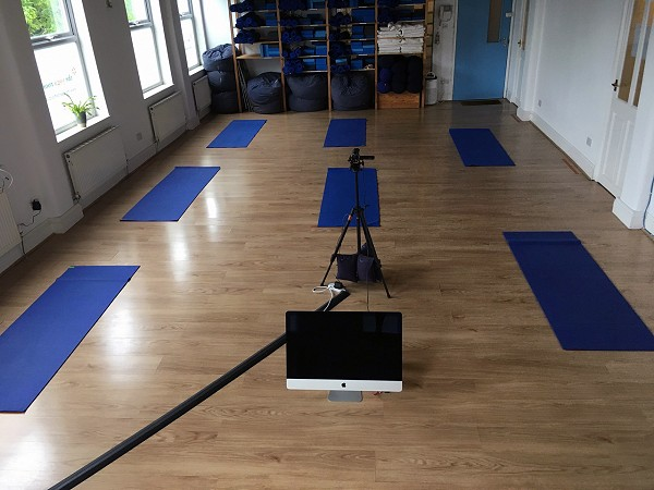 The Yoga Rooms Studio with yoga mats and online broadcast equipment