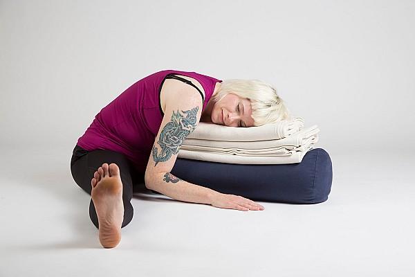 Yoga student in restorative forward fold